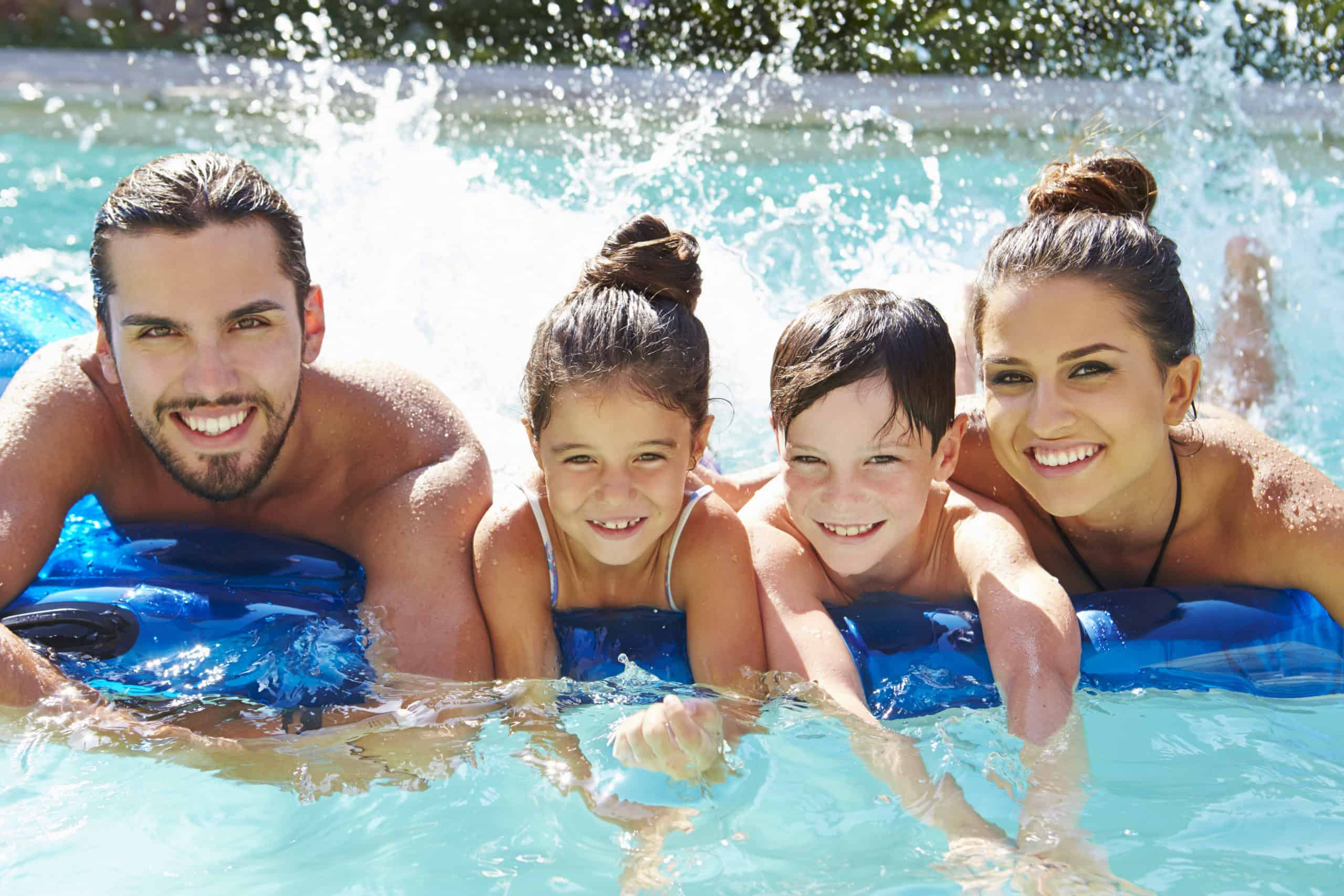 Portrait Of Family In a Swimming Pool