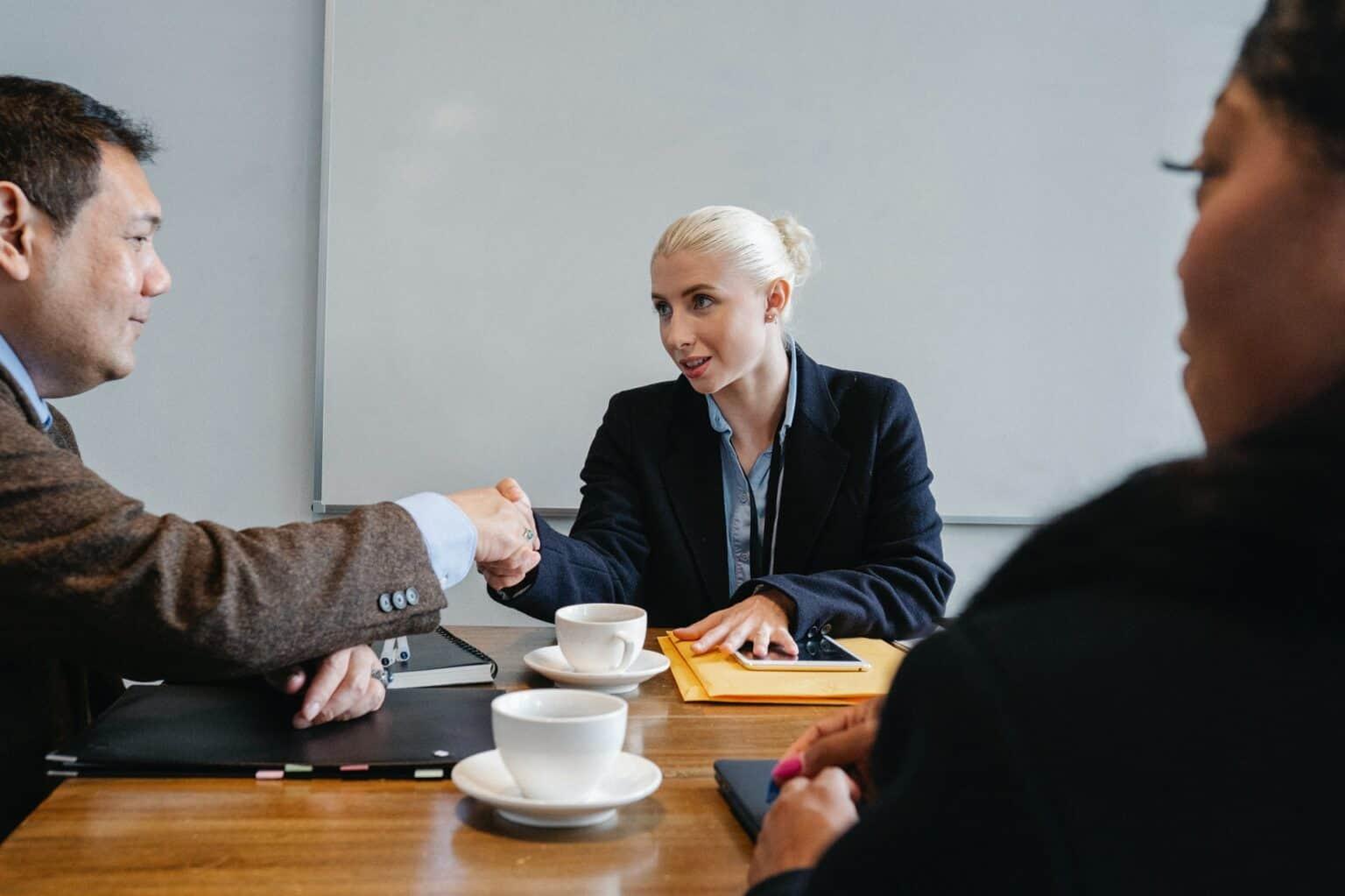 Multiple Business People Striking Deal in Office